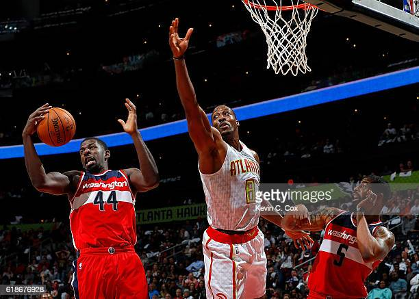 Andrew Nicholson of the Washington Wizards grabs a rebound against Dwight Howard of the Atlanta Hawks at Philips Arena on October 27 2016 in Atlanta...