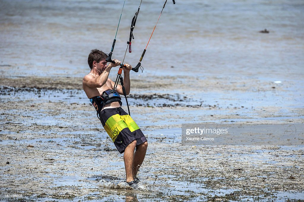 Andrew Norman of South Africa prepares hi kite on the beach during day four of the 1st KTA Bintan at Argo Beach Resort on February 24, 2013 in Bintan Island, Indonesia.