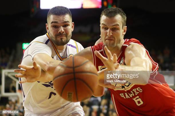 Andrew Ogilvy of the Hawks and Isaac Humphries of the Kings compete for the ball during the round four NBL match between the Illawarra Hawks and the...