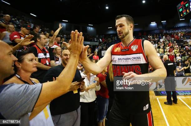 Andrew Ogilvy of the Hawks greets fans after the second NBL Semi Final match between Illawarra Hawks and the Adelaide 36ers at WIN Entertainment...