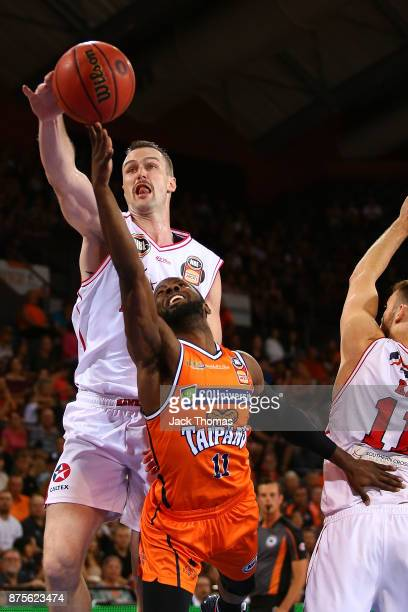 Andrew Ogilvy of the Illawarra Hawks blocks Dayshon Smith of the Cairns Taipans shot during the round seven NBL match between Cairns and Illawarra at...