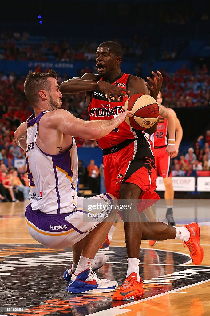 Andrew Ogilvy of the Kings is fouled by <a gi-track='captionPersonalityLinkClicked' href=/galleries/search?phrase=James+Ennis&family=editorial&specificpeople=8677438 ng-click='$event.stopPropagation()'>James Ennis</a> of the Wildcats during the round two NBL match between the Perth Wildcats and the Sydney Kings at Perth Arena in October 18, 2013 in Perth, Australia.