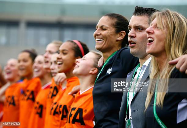 Andrew Olivieri of Canada sings their national anthem prior to the FIFA U20 Women's World Cup Canada 2014 Quarter Final match between Germany and...