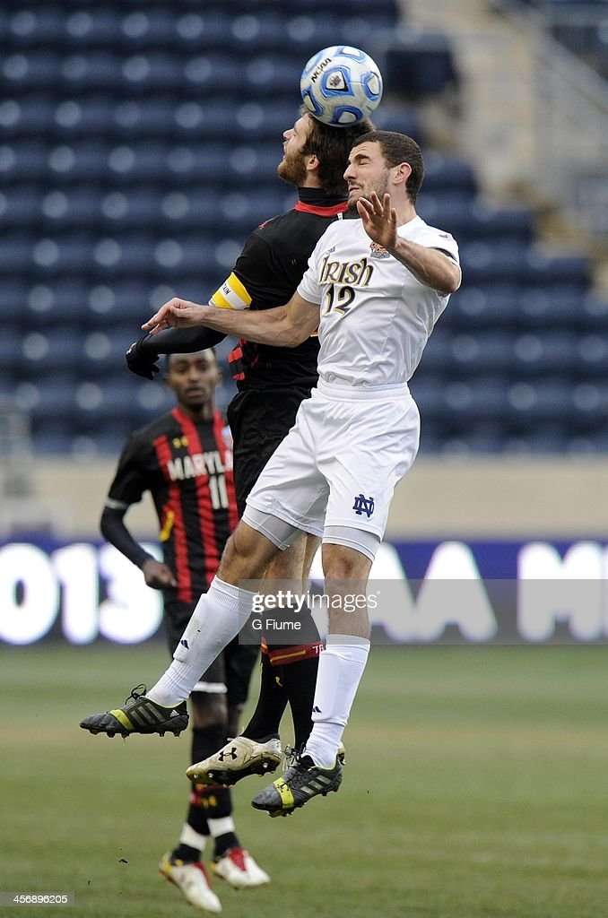 Andrew O'Malley #12 of the Notre Dame Fighting Irish goes up for the ball in the second half against Patrick Mullins #15 of the Maryland Terrapins during the 2013 NCAA Men's College Cup at PPL Park on December 15, 2013 in Chester, Pennsylvania. Notre Dame won the championship 2-1.