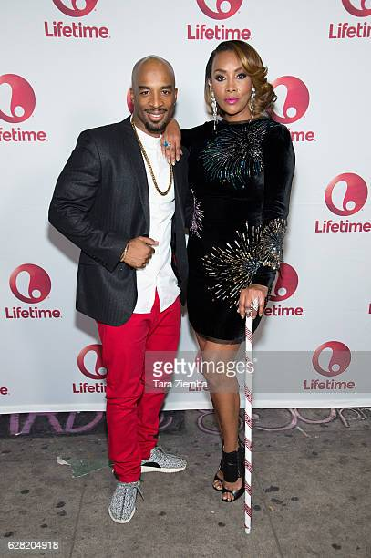 Andrew 'Penetration' Williams and Vivica A Fox attend a live performance and holiday party for Lifetime's 'Vivica's Black Magic' at The Mint on...