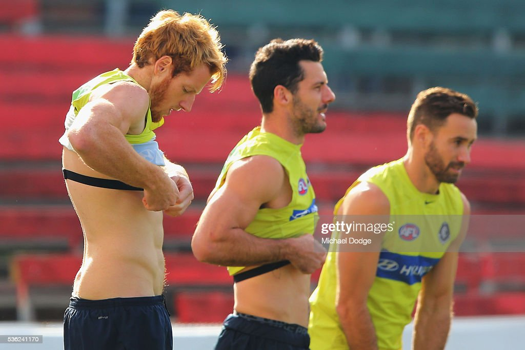 Andrew Phillips of the Blues (L) and Simon White strap on their heart rate monitors during the Carlton Blues AFL training session at Ikon Park on June 1, 2016 in Melbourne, Australia.