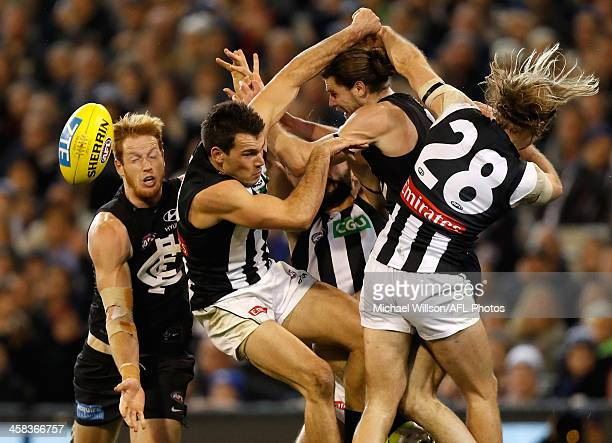 Andrew Phillips of the Blues Levi Greenwood of the Magpies Bryce Gibbs of the Blues and Ben Sinclair of the Magpies compete for the ball during the...