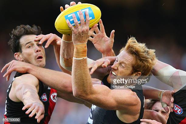 Andrew Phillips of the Blues marks the ball against Matt Dea of the Bombers during the round six AFL match between the Carlton Blues and the Essendon...
