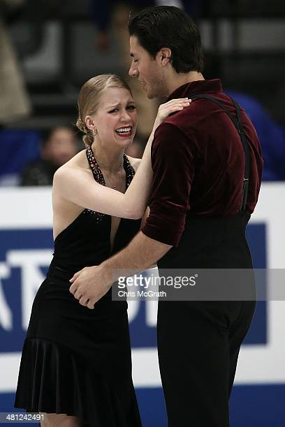 Andrew Poje and Kaitlyn Weaver of Canada react after finishing their routine in the Ice Dance Free Dance during ISU World Figure Skating...
