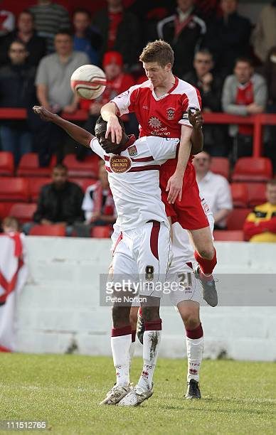 Andrew Procter of Accrington Stanley contests the ball with Abdul Osman of Northampton Town during the npower League Two League match between...
