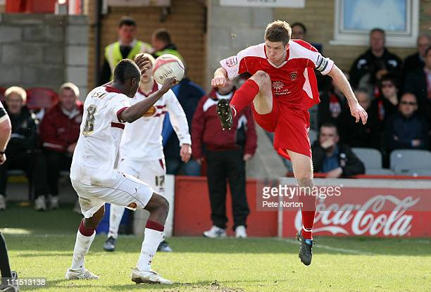 Andrew Procter of Accrington Stanley plays the ball over the head of Abdul Osman of Northampton Town during the npower League Two League match...