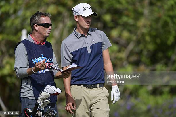 Andrew Putnam discusses his next shot with his caddy on the second hole during the final round of The Bahamas Great Exuma Classic at Sandals Emerald...