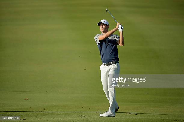 Andrew Putnam hits his second shot on the 11th hole during the first round of The Bahamas Great Abaco Classic at Abaco Club on January 22 2017 in...