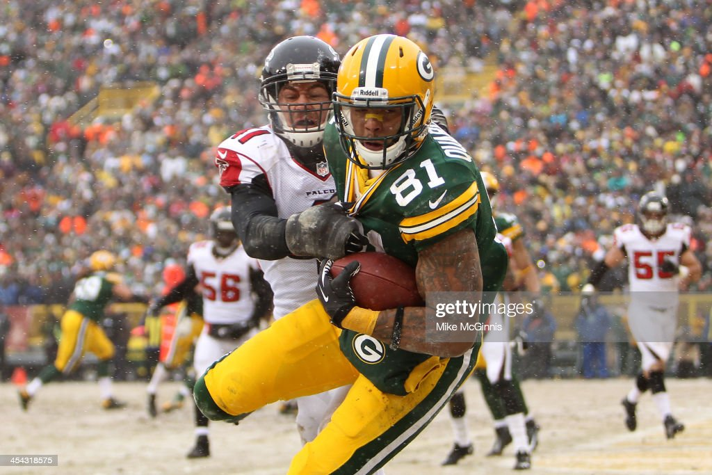 <a gi-track='captionPersonalityLinkClicked' href=/galleries/search?phrase=Andrew+Quarless&family=editorial&specificpeople=3977278 ng-click='$event.stopPropagation()'>Andrew Quarless</a> #81 of the Green Bay Packers makes the catch in the endzone for a touchdown during the second half of play against the Atlanta Falcons at Lambeau Field on December 08, 2013 in Green Bay, Wisconsin.