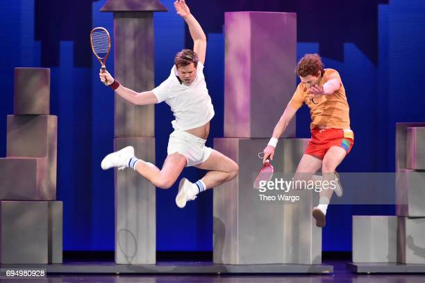 Andrew Rannells and Christian Borle perform with the cast of 'Falsettos' onstage during the 2017 Tony Awards at Radio City Music Hall on June 11 2017...