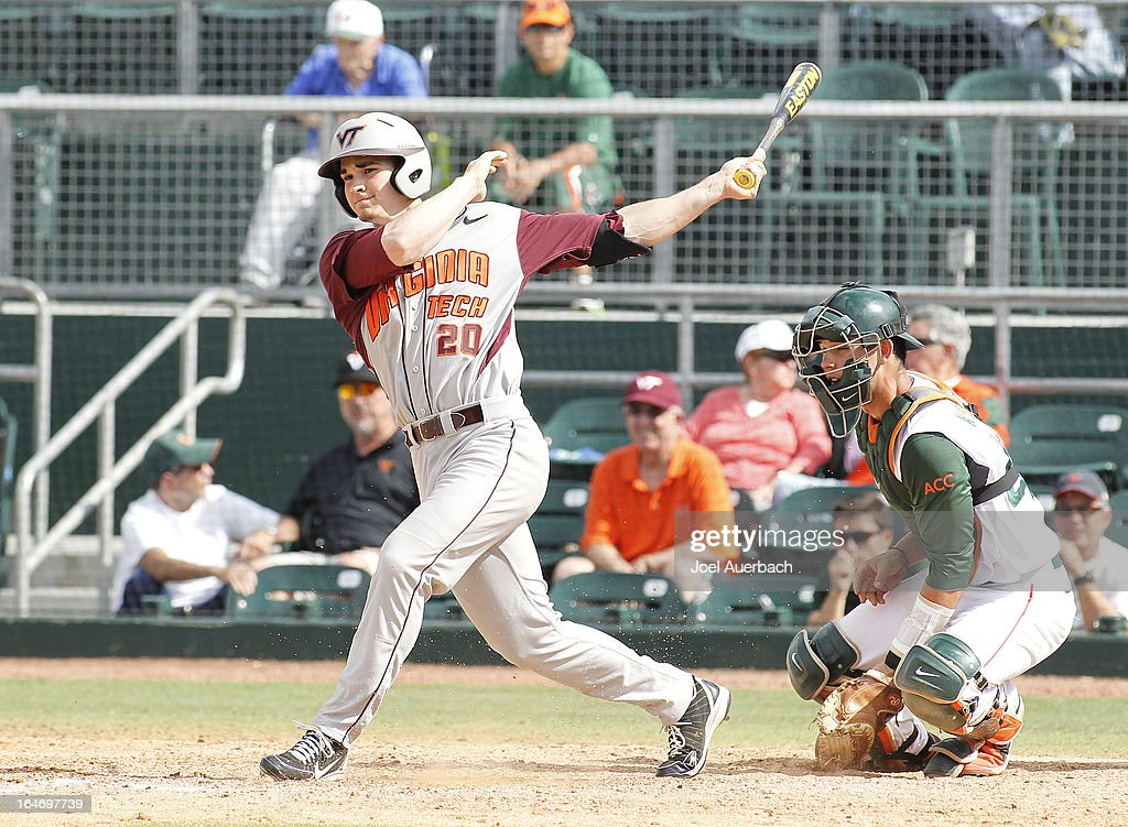 Andrew Rash #20 of the Virginia Tech Hokies hits a double driving in two runs against the Miami Hurricanes in the top of the tenth inning on March 24, 2013 at Alex Rodriguez Park at Mark Light Field in Coral Gables, Florida. Virginia Tech defeated Miami 8-5 in 10 innings.