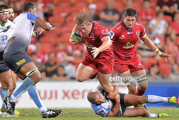 Andrew Ready of the Reds attempts to break away from the defence during the round two Super Rugby match between the Reds and the Force at Suncorp...