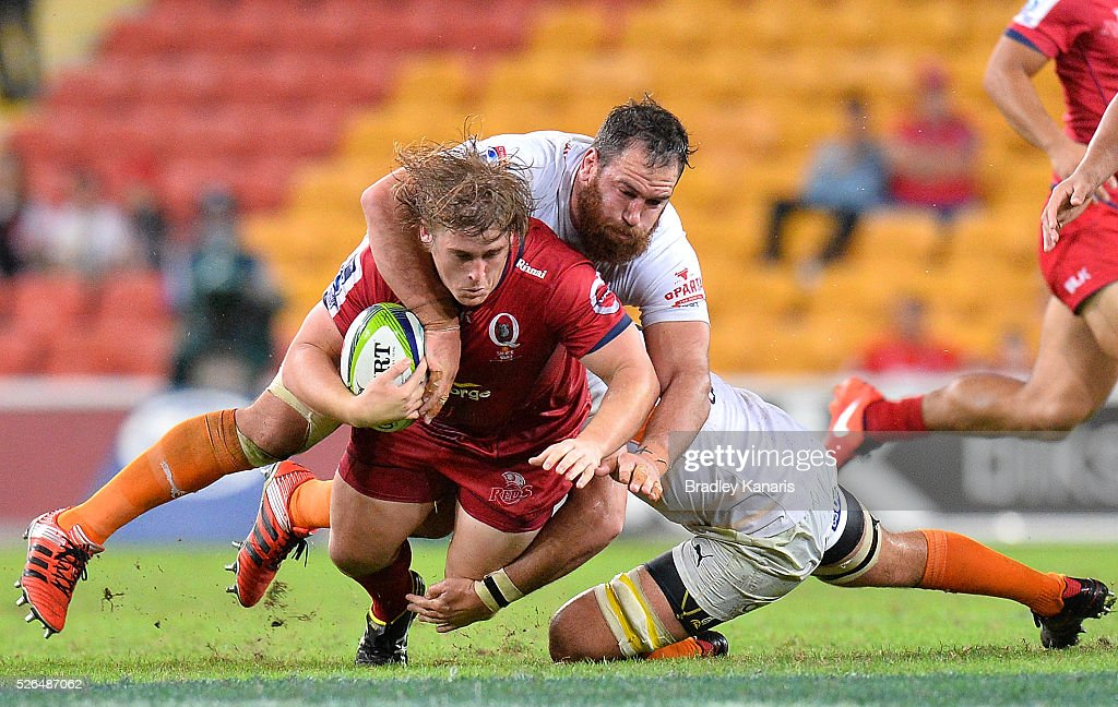 Andrew Ready of the Reds is tackled during the round 10 Super Rugby match between the Reds and the Cheetahs at Suncorp Stadium on April 30, 2016 in Brisbane, Australia.