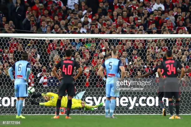 Andrew Redmayne of Sydney FC saves a penalty kick attempt by Danny Welbeck of Arsenal during the match between Sydney FC and Arsenal FC at ANZ...