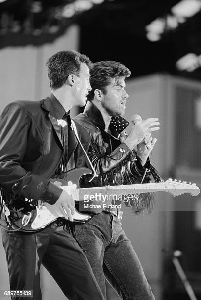 Andrew Ridgeley and George Michael of pop duo Wham performing at their farewell concert entitled 'The Final' at Wembley Stadium London 28th June 1986