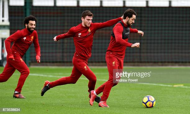 Andrew Robertson and Danny Ings of Liverpool during a training session at Melwood Training Ground on November 13 2017 in Liverpool England