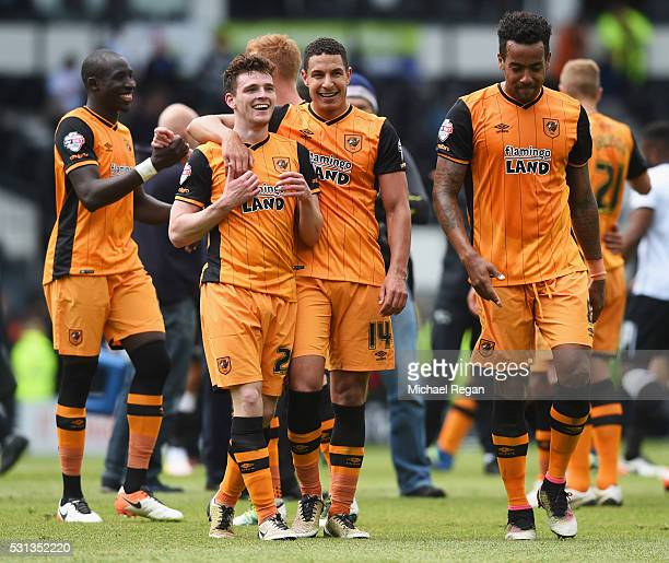 Andrew Robertson and Jake Livermore of Hull City celebrate victory with team mates after the Sky Bet Championship Play Off semi final first leg match...