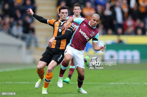 Andrew Robertson of Hull City and Sofiane Feghouli of West Ham United battle for possession during the Premier League match between Hull City and...