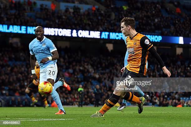 Andrew Robertson of Hull City scores his side's first goal during the Capital One Cup Quarter Final match between Manchester City and Hull City at...