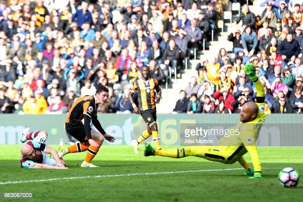 Andrew Robertson of Hull City scores his sides first goal during the Premier League match between Hull City and West Ham United at KCOM Stadium on...