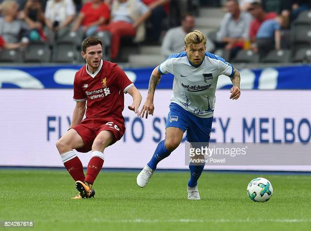 Andrew Robertson of Liverpool competes with Alexander Esswein of Hertha BSC during the preseason friendly match between Hertha BSC and FC Liverpool...