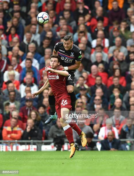 Andrew Robertson of Liverpool competes with Joel Ward of Crystal Palace during the Premier League match between Liverpool and Crystal Palace at...