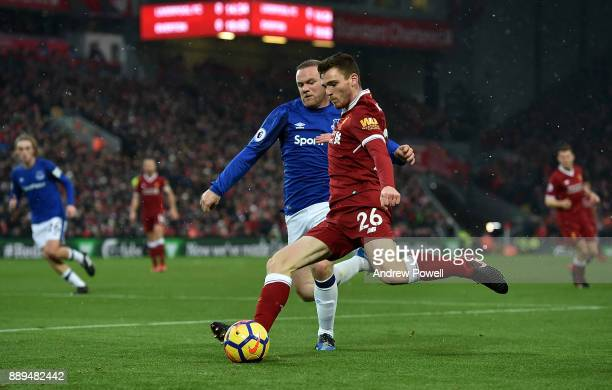 Andrew Robertson of Liverpool competes with Wayne Rooney of Everton during the Premier League match between Liverpool and Everton at Anfield on...