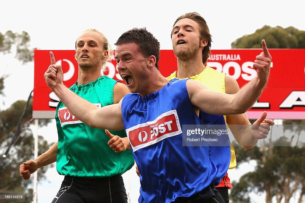 Andrew Robinson of Tasmania celebrates as he crosses the line to win the Australia Post Stawell Gift 120m Final during the 2013 Stawell Gift carnival at Central Park on April 1, 2013 in Stawell, Australia.