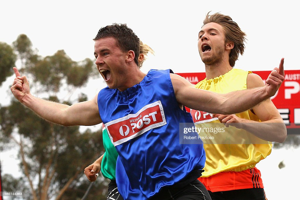 Andrew Robinson (blue) of Tasmania celebrates as he crosses the line to win the Australia Post Stawell Gift 120m Final during the 2013 Stawell Gift carnival at Central Park on April 1, 2013 in Stawell, Australia.