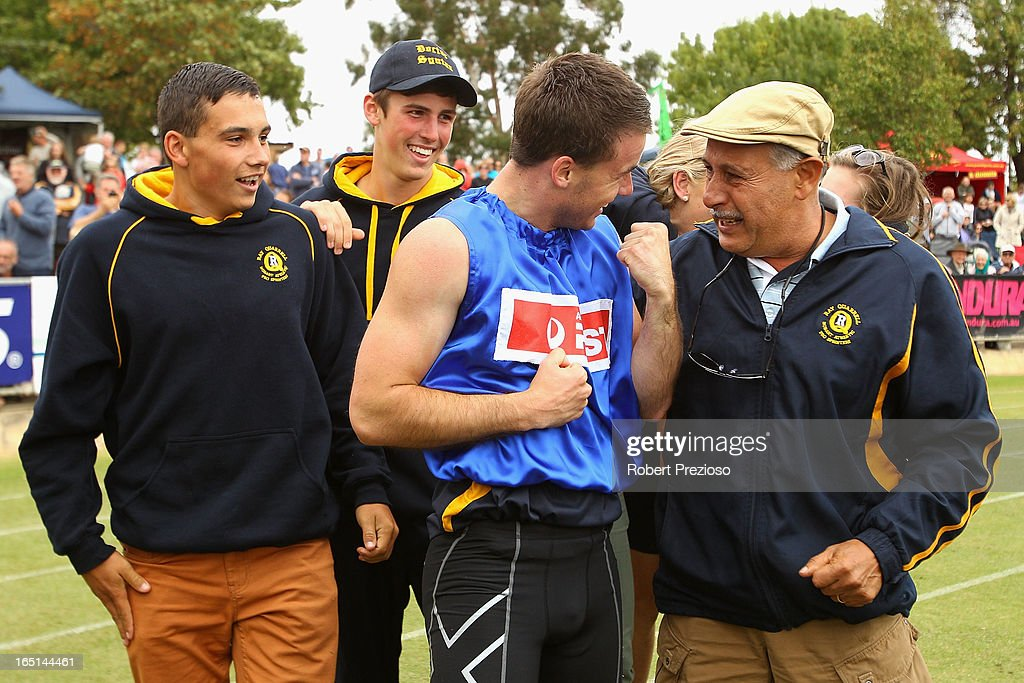 Andrew Robinson of Tasmania celebrates with his coach Ray Quarrell after winning the Australia Post Stawell Gift 120m Final during the 2013 Stawell Gift carnival at Central Park on April 1, 2013 in Stawell, Australia.