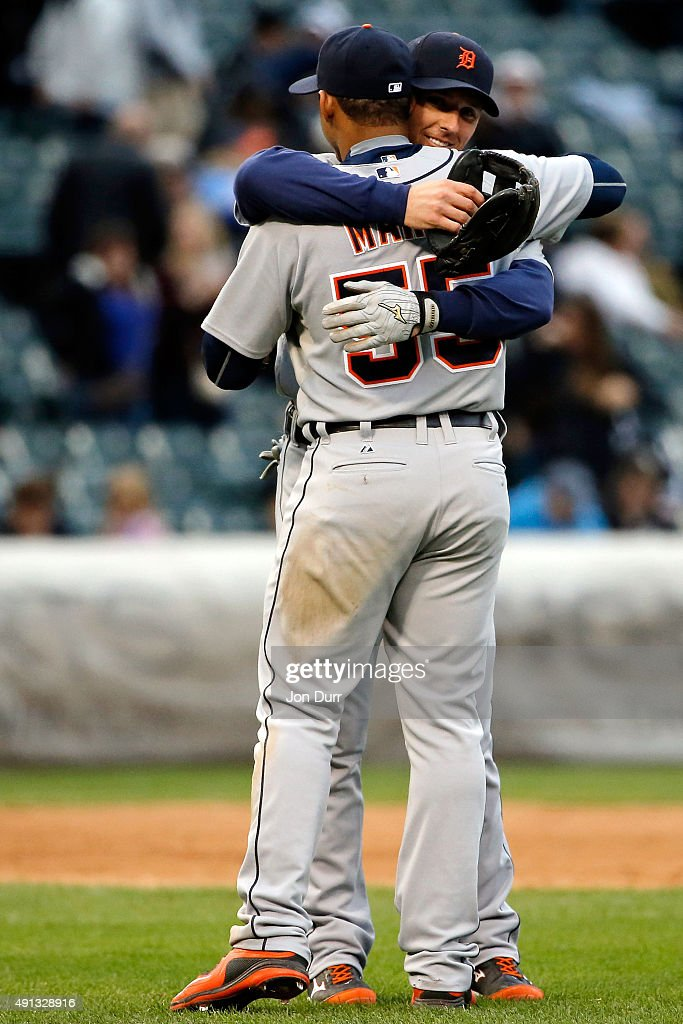 Andrew Romine #27 of the Detroit Tigers (back) and Jefry Marte #55 celebrate their win against the Chicago White Sox at U.S. Cellular Field on October 4, 2015 in Chicago, Illinois. The Detroit Tigers won 6-0.