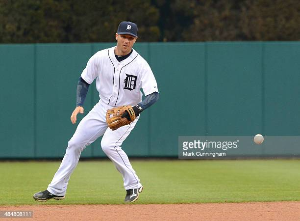Andrew Romine of the Detroit Tigers fields during the game against the Baltimore Orioles at Comerica Park on April 4 2014 in Detroit Michigan The...