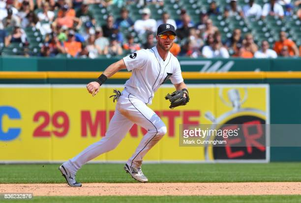 Andrew Romine of the Detroit Tigers fields during the game against the Los Angeles Dodgers at Comerica Park on August 20 2017 in Detroit Michigan The...