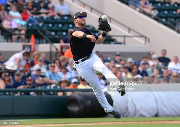 Andrew Romine of the Detroit Tigers fields during the Spring Training game against the Atlanta Braves at Publix Field at Joker Marchant Stadium on...
