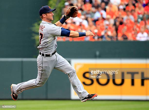 Andrew Romine of the Detroit Tigers fields the ball hit by Steve Pearce of the Baltimore Orioles in the second inning during Game Two of the American...