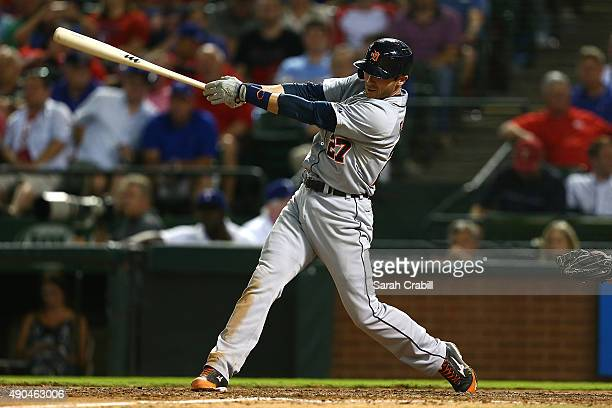 Andrew Romine of the Detroit Tigers hits a single in the seventh inning during a game against the Texas Rangers at Globe Life Park in Arlington on...