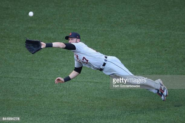 Andrew Romine of the Detroit Tigers makes a diving catch in the second inning during MLB game action against the Toronto Blue Jays at Rogers Centre...