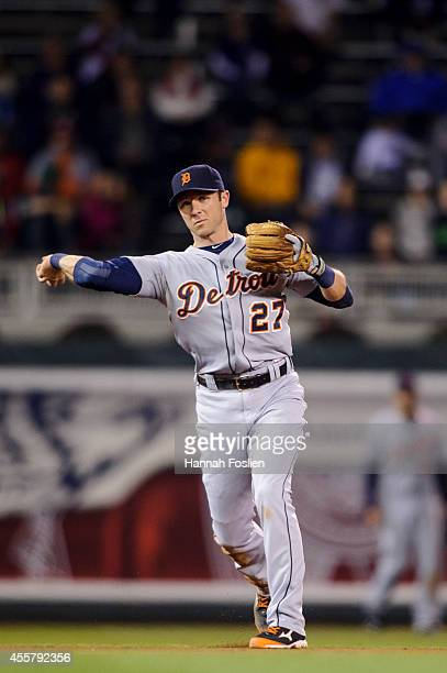 Andrew Romine of the Detroit Tigers makes a play at shortstop against the Minnesota Twins during the game on September 15 2014 at Target Field in...