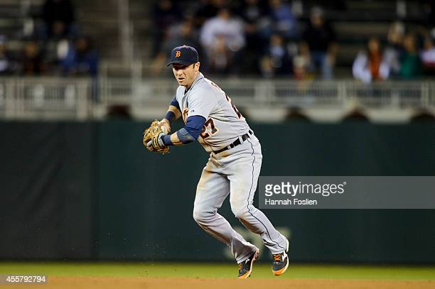 Andrew Romine of the Detroit Tigers makes a play at shortstop against the Minnesota Twins during the game on September 16 2014 at Target Field in...