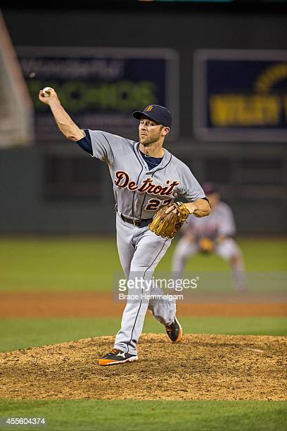 Andrew Romine of the Detroit Tigers pitches against the Minnesota Twins on August 22 2014 at Target Field in Minneapolis Minnesota The Twins defeated...