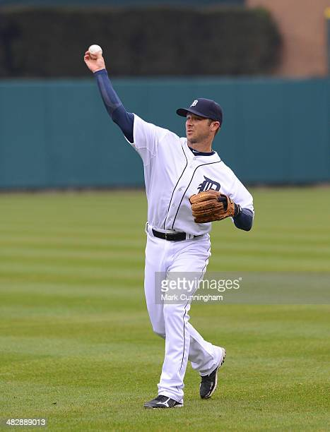 Andrew Romine of the Detroit Tigers plays catch prior to the game against the Baltimore Orioles at Comerica Park on April 4 2014 in Detroit Michigan...