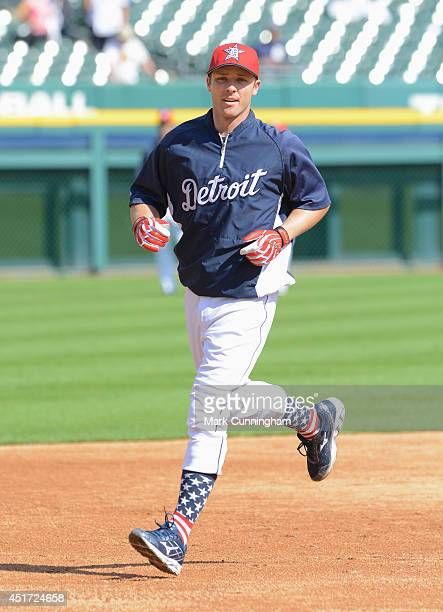 Andrew Romine of the Detroit Tigers runs the bases during batting practice while wearing special red white and blue socks and hat to honor...