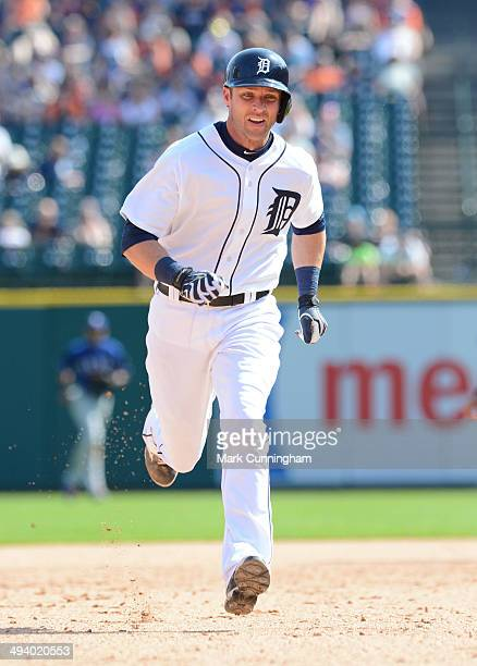 Andrew Romine of the Detroit Tigers runs the bases during the game against the Texas Rangers at Comerica Park on May 25 2014 in Detroit Michigan The...