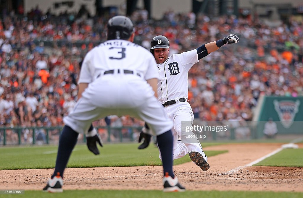 <a gi-track='captionPersonalityLinkClicked' href=/galleries/search?phrase=Andrew+Romine&family=editorial&specificpeople=2338123 ng-click='$event.stopPropagation()'>Andrew Romine</a> #27 of the Detroit Tigers scores on the double by <a gi-track='captionPersonalityLinkClicked' href=/galleries/search?phrase=Anthony+Gose&family=editorial&specificpeople=6906091 ng-click='$event.stopPropagation()'>Anthony Gose</a> #12 (not in photo) during the fourth inning of the game against the Houston Astros on May 24, 2015 at Comerica Park in Detroit, Michigan.