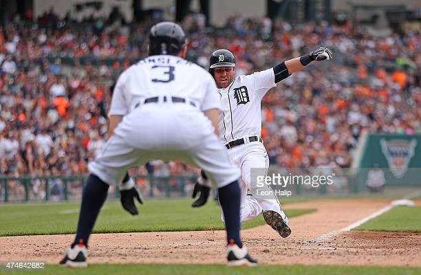 Andrew Romine of the Detroit Tigers scores on the double by Anthony Gose during the fourth inning of the game against the Houston Astros on May 24...